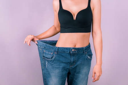 A young woman showing off a slim figure Exercise regularly, be healthy Stockfoto