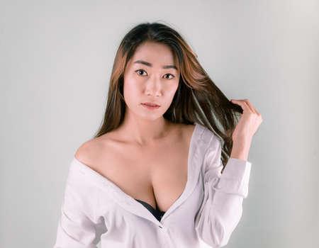 Sexy asian woman in good shape, white skin, taken in a studio