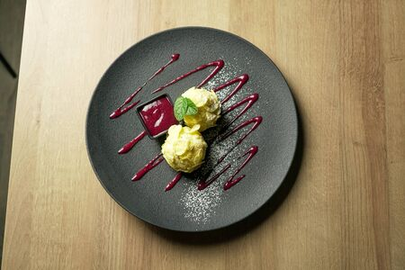 Dessert on a restaurant table Archivio Fotografico - 137785999