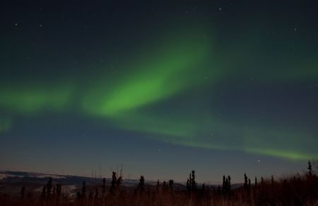 The Aurora Transforming Quickly In The Alaska Night Sky