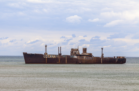 ethan: An old cargo ship has run aground in the shallow in the Black Sea, Romania. This shipwreck is abandonated for several years.