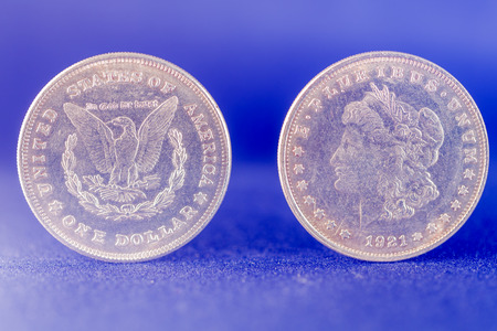 One dollar silver coin front and reverse
