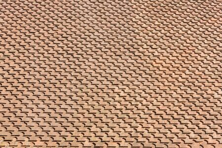 Brown roof tile pattern (background) on sunset light photo