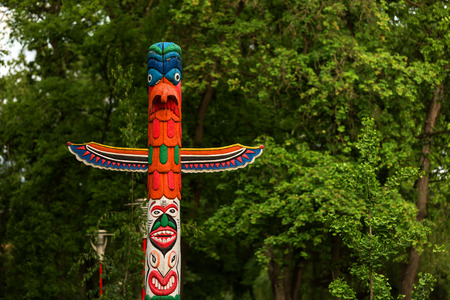 Indian totem with forest background in a park
