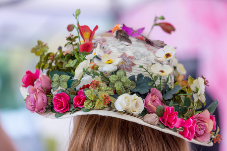 Hat with natural and artificial spring flowers Stock Photo - 41799718