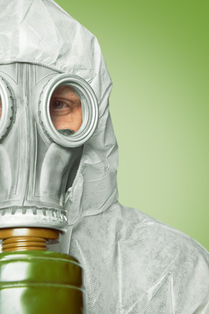 Half face of man in respirator and protective uniform, space for text photo