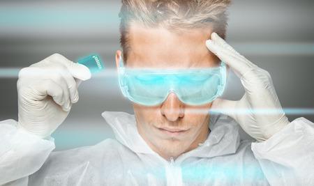 futuristic man: Man in futuristic clothing holds memory card near his head