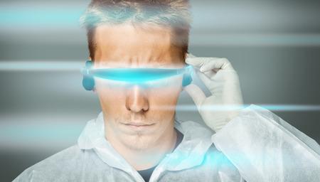 futuristic man: Serious man in futuristic glasses and wear