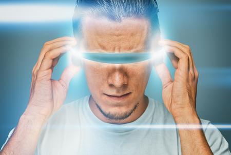 robot head: Serious man in hi-tech glasses, futuristic concept Stock Photo
