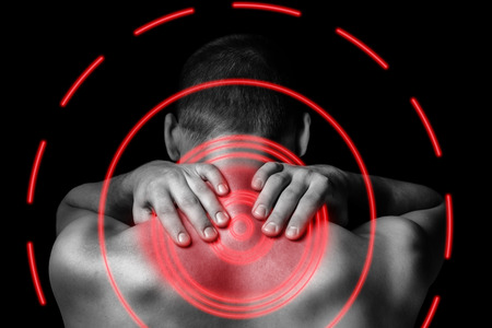back back: Unrecognizable man touches neck, pain in the neck, rear view, pain area of red color Stock Photo