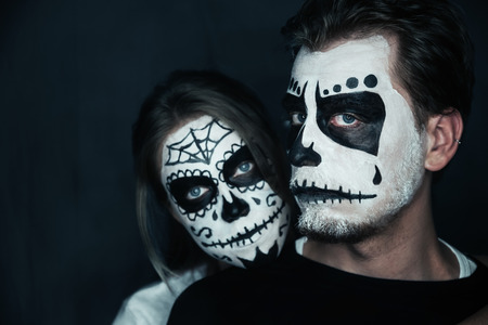 couple with dark skull makeup on black halloween face art stock photo 32706070