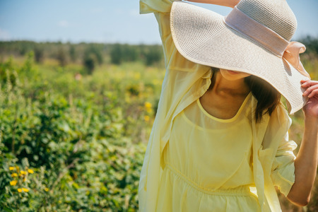 brim: Attractive woman in hat with wide brim on summer nature Stock Photo