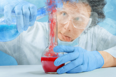 mad scientist: Mad scientist is pouring chemical liquid into laboratory tube
