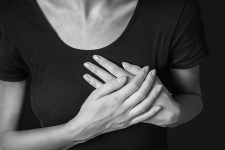 nude woman: Woman is clutching her chest, acute pain possible heart attack, monochrome image