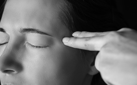 murdering: Sad woman makes gesture shot gun in a head Stock Photo