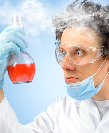 failed: Surprised crazy scientist with test tube Stock Photo