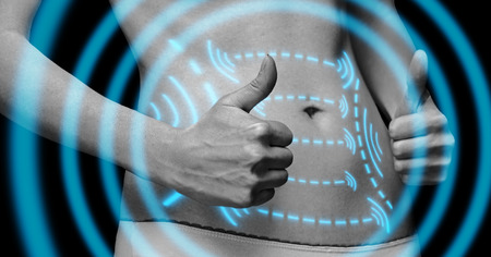 fat concept: Woman with gesture sign thumb up in front of her abdomen, monochrome image. Arrows on belly, fat loss and liposuction concept