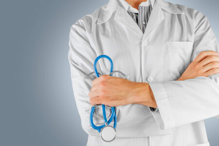 male doctor: Confident male doctor with arms crossed. The face is not visible
