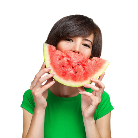 Smiling young woman holding watermelon on a white background photo