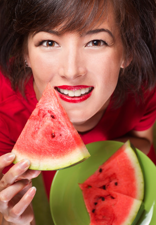 Young beautiful woman with slice of watermelon, top view photo