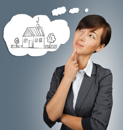 Woman thinks about the home Stock Photo