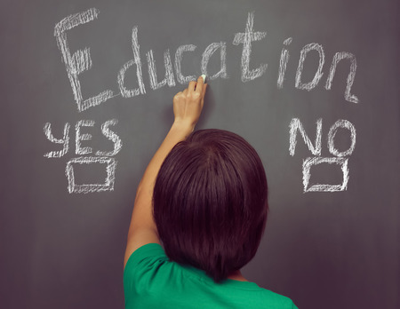 education choice: Unrecognizable woman writes choice education on the blackboard, concept of education