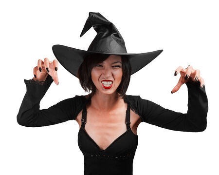 mage: Halloween witch standing with arms raised on a white background