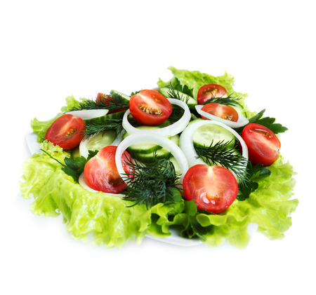 side salad: Fresh salad of cucumber, cherry tomatoes, onion rings and dill, side view