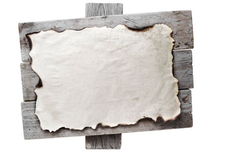 burnt wood: Old burnt paper on a wooden board. Space for text Stock Photo