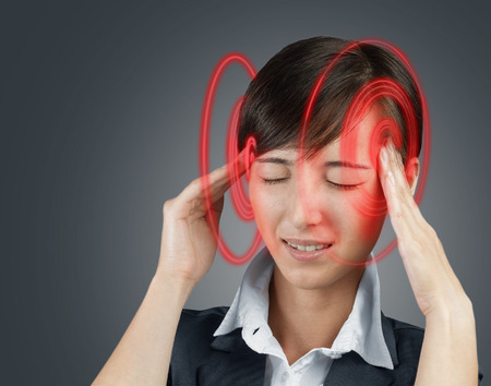 temporal: Young woman is touching her head, the temporal region of red color