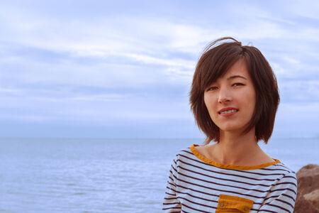 striped vest: Portrait of a beautiful girl in a striped vest