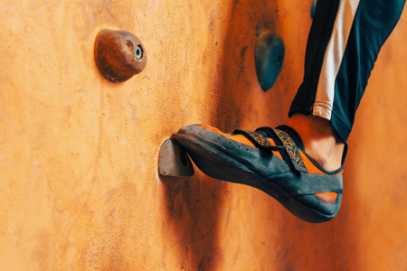 rock wall: Close-up image of male foot on climbing wall