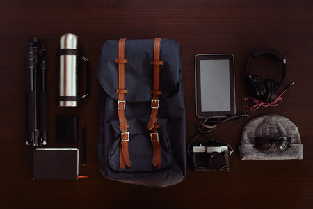 thermos: Still life of objects for traveler photographer on wooden background