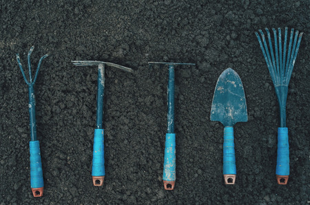mattock: Different gardening tools on soil, top view Stock Photo