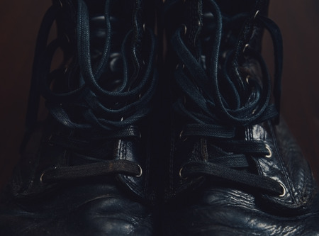 shoelaces: Black leather boots with shoelaces, close-up Stock Photo