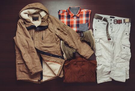 parka: Set of fashionable male apparel in casual style on wooden