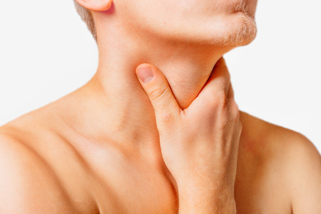 tonsillitis: Man touches the throat, sore throat.