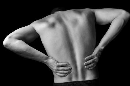 sports massage: Dolor agudo en un macho de espalda baja, imagen monocroma Foto de archivo