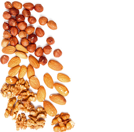 dry food: Different nuts on a white , space for text