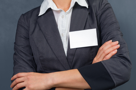 unrecognizable: Unrecognizable businesswoman with id card on the chest, copyspace