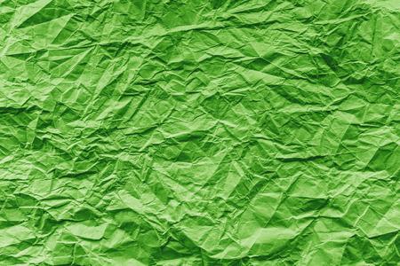 Green crumpled paper , texture