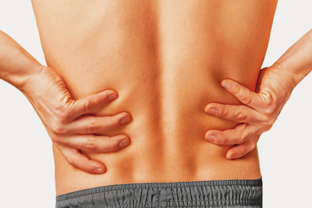chiropractic: Acute pain in a male lower back. Stock Photo