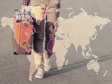 Double exposure map of the world combined with image of traveler with suitcase. Concept of travel