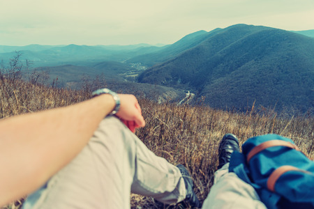 point of view: Traveler man resting in the mountains. Point of view shot. Focus on nature Stock Photo