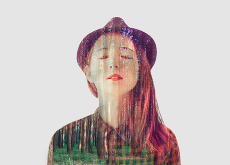multiple exposure: Double exposure portrait of beautiful girl combined with image of trees in forest Stock Photo