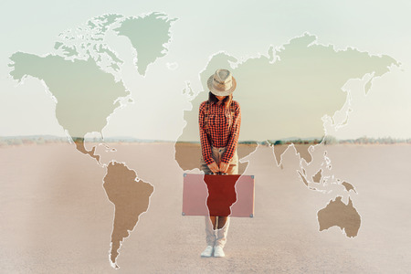 Double exposure map of world combined with image of traveler woman with suitcase on road. Concept of travel photo