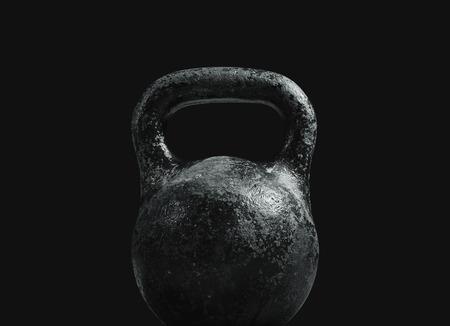 black metallic background: Metallic kettlebell on a black background