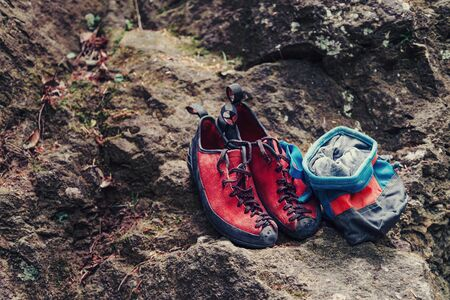magnesia: Climbing shoes and sack with magnesium powder on stone rock Stock Photo