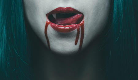 Sensual female vampire lips in blood, close-up image. Halloween or horror theme Stock Photo
