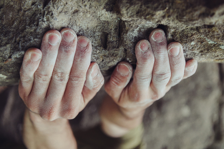 rock wall: Close-up of male climber hands in magnesium powder on stone rock